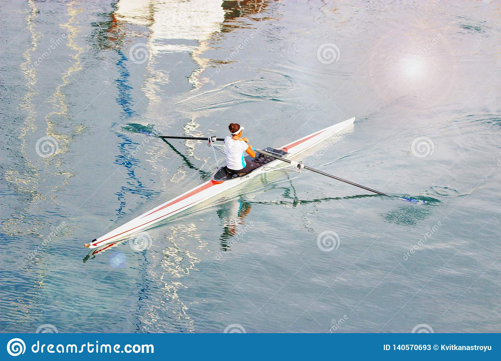 Young woman paddling a kayak. Sport, active lifestyle