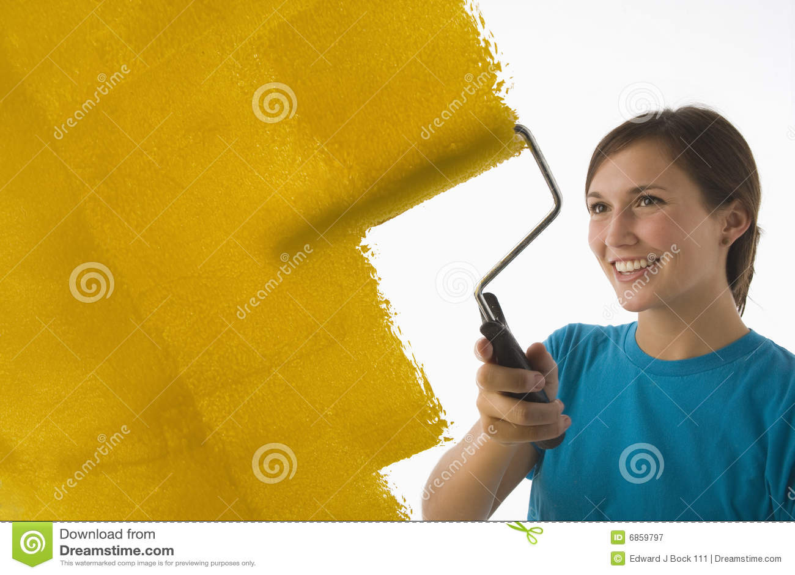 Young woman painting walls