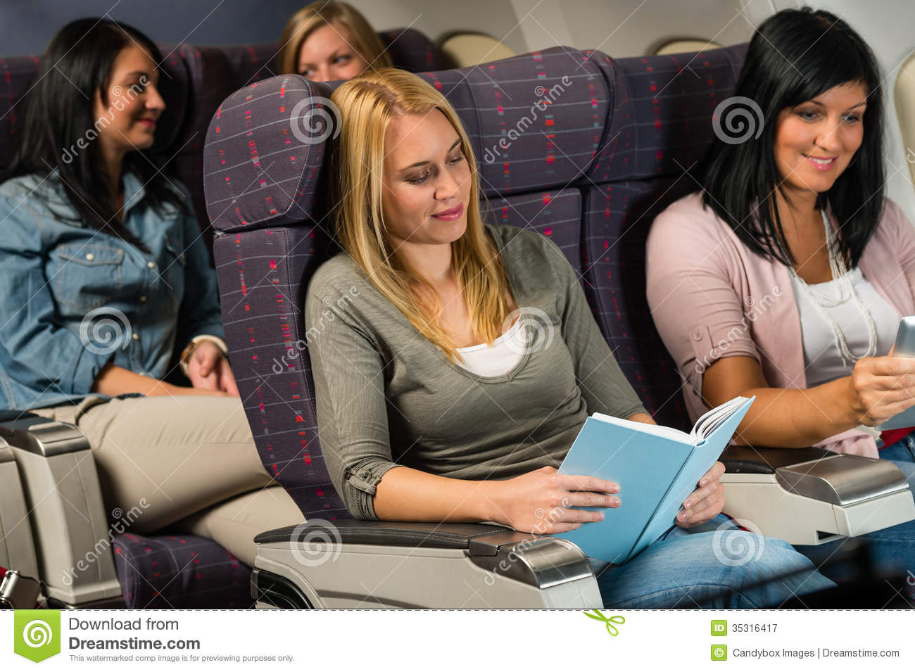 Young woman passenger read book airplane flight stock for The girl in the cabin