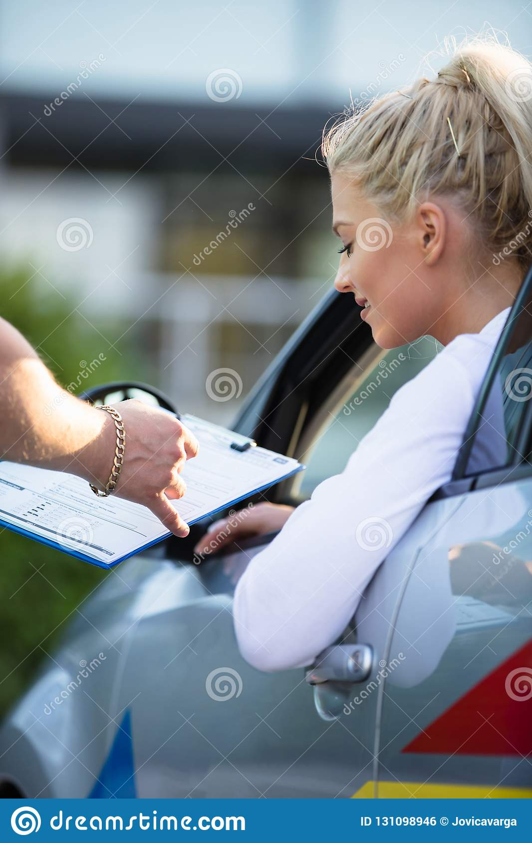 Young woman passing driving license exam
