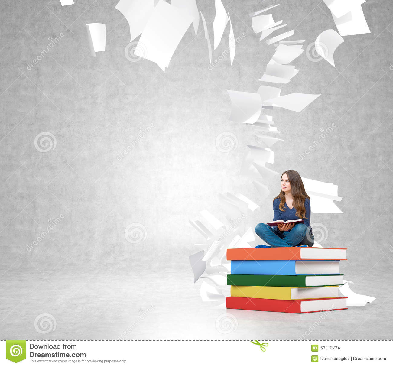 young woman on pile of books with paper flying around