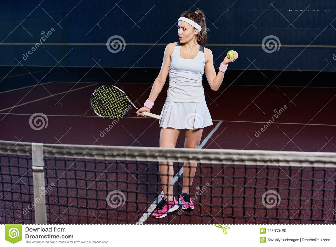Young Woman Playing Tennis In Court Stock Photo Image Of Flash