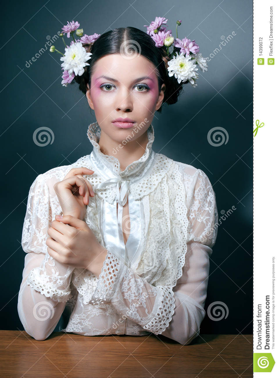 Young Woman Portrait With Fresh Flowers In Hair Stock