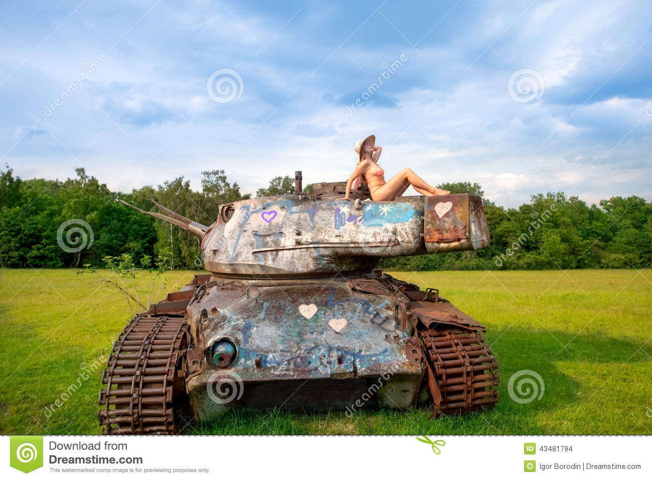 Young Woman Posing On Army Tank. Stock Photo - Image: 43481794