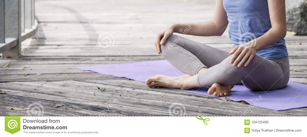 Young woman practicing yoga during yoga retreat in Asia, Bali, meditation, relaxation in abandoned temple