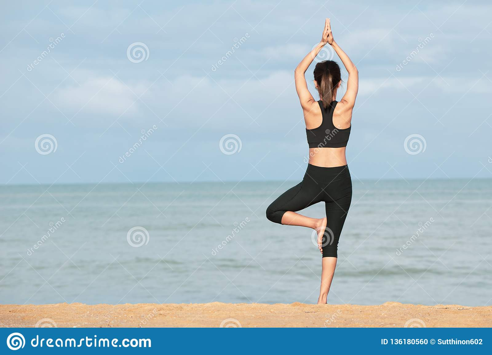 Young woman practicing yoga in the nature, Female happiness, Young woman practicing yoga on the beach