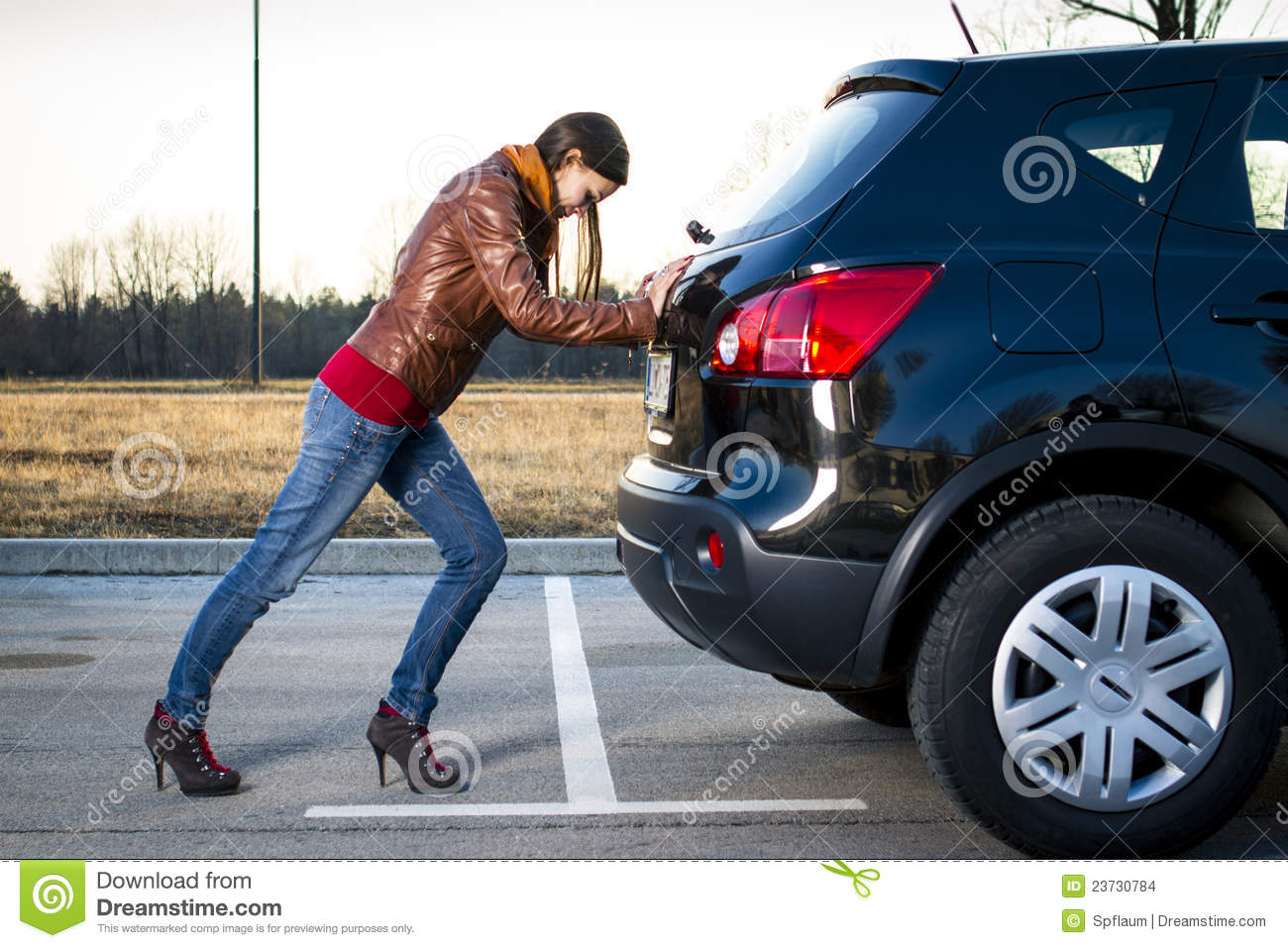 young woman pushing car stock photo image of problem 23730784