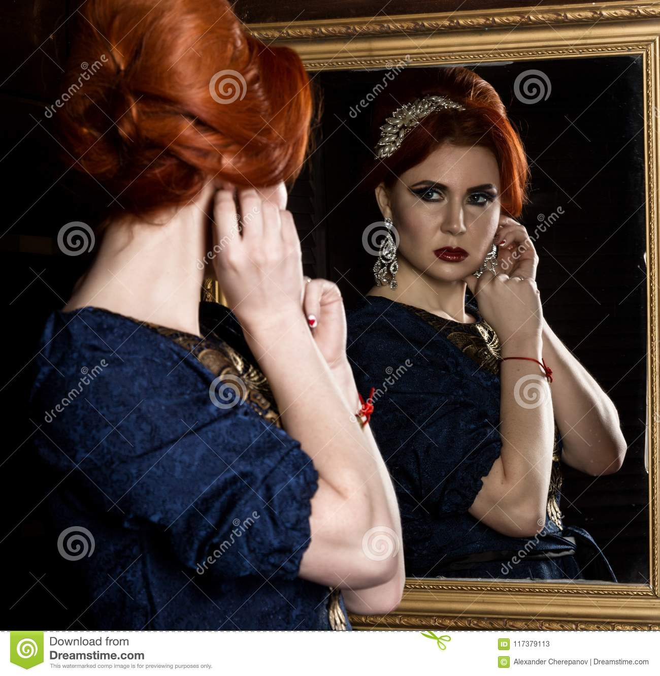 Young Woman Puts On Beautiful Earrings In Front Of Mirror Beautiful
