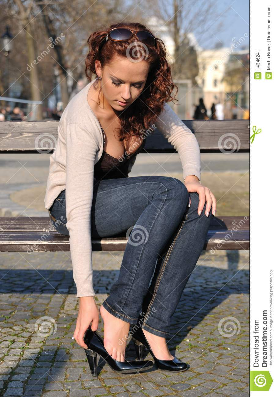 Young Woman Putting On Shoes Stock Image Image Of Jeans