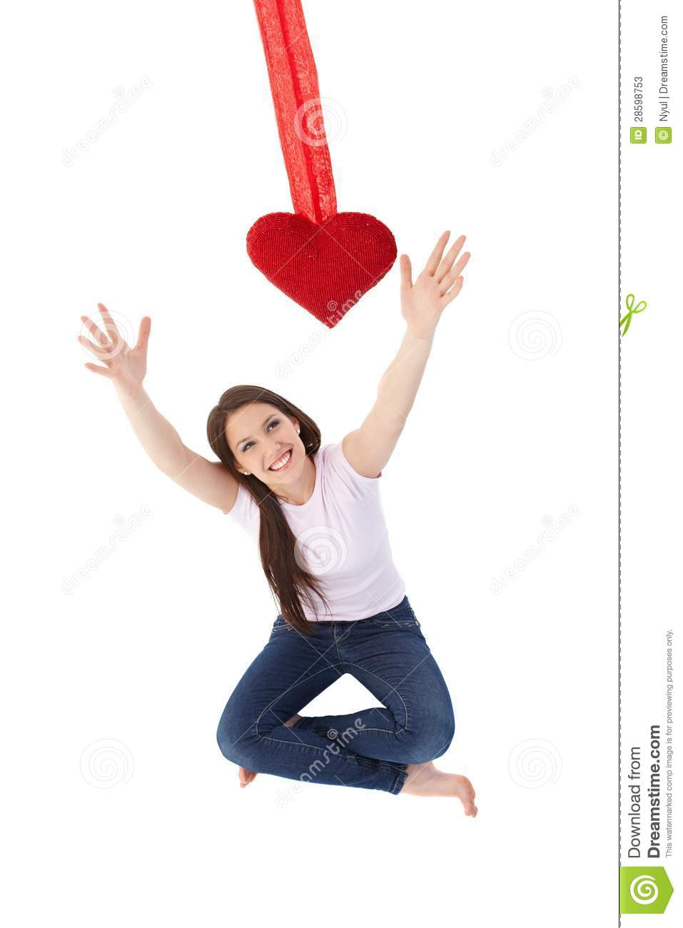 young woman reaching out for red heart smiling stock