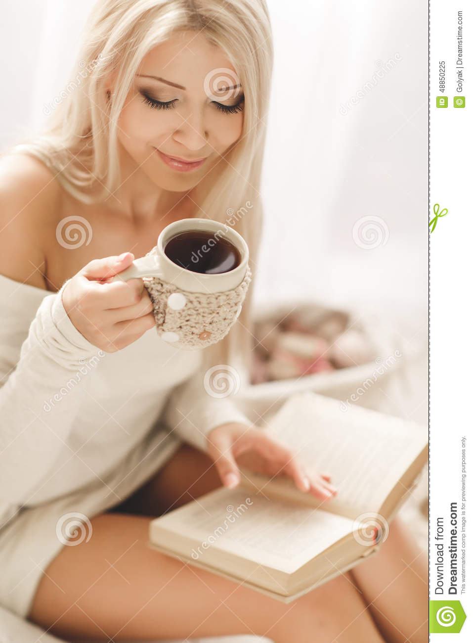 Young Woman Reading A Book And Drinking Coffee Stock