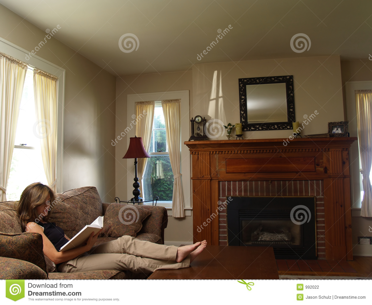 Young woman reading, relaxed