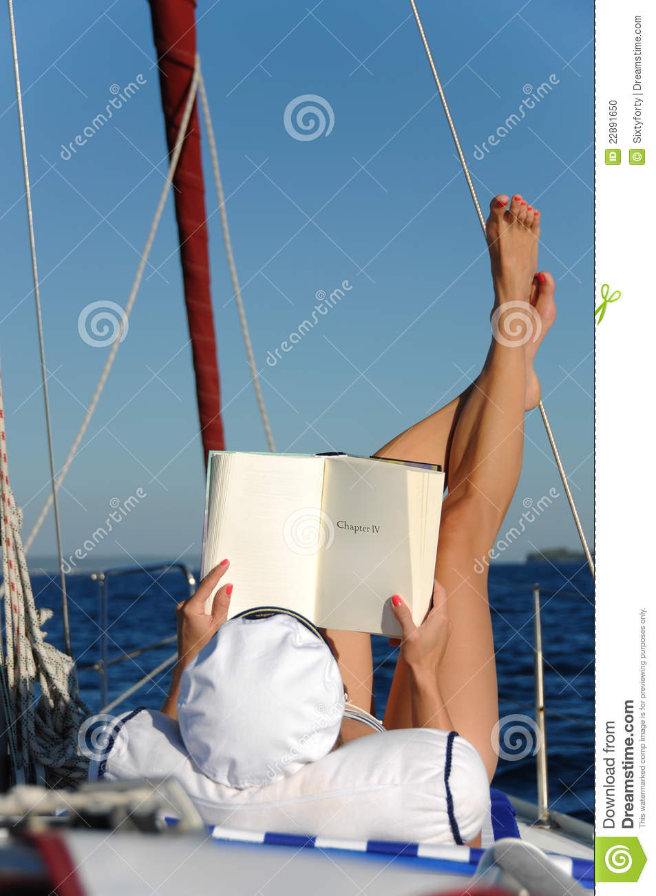 Worksheet Reading Boat young woman reading and sunbathing on sail boat stock photo boat