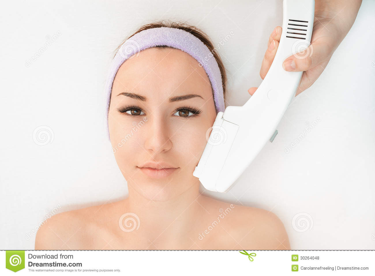 young woman receiving epilation laser treatment royalty free stock photos image 30264048. Black Bedroom Furniture Sets. Home Design Ideas