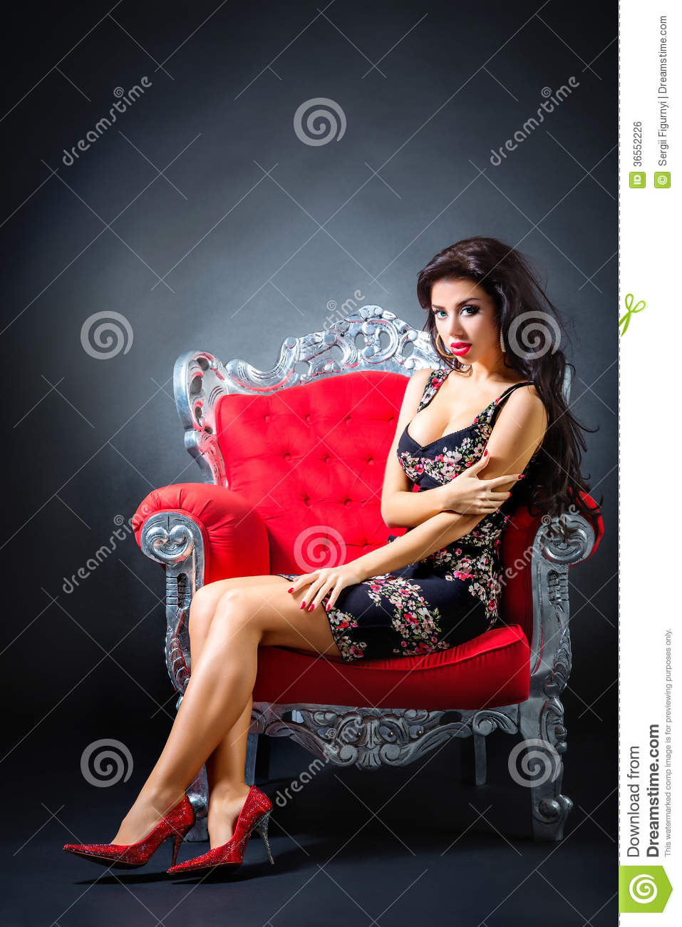nude woman in a red armchair .