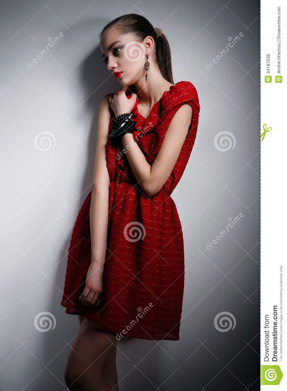 Creative Beauty Woman Holds Dress And Looks Up Royalty Free Stock Photography