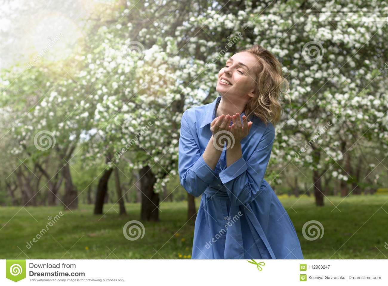 Young Woman Rejoices by the Sunlight. Spring Concept