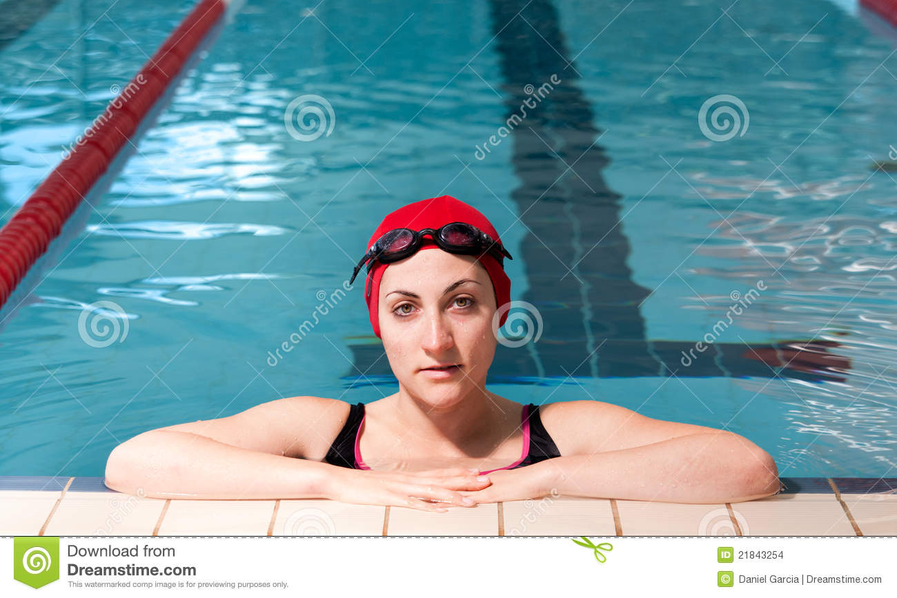 Young woman relaxed on swimming pool.