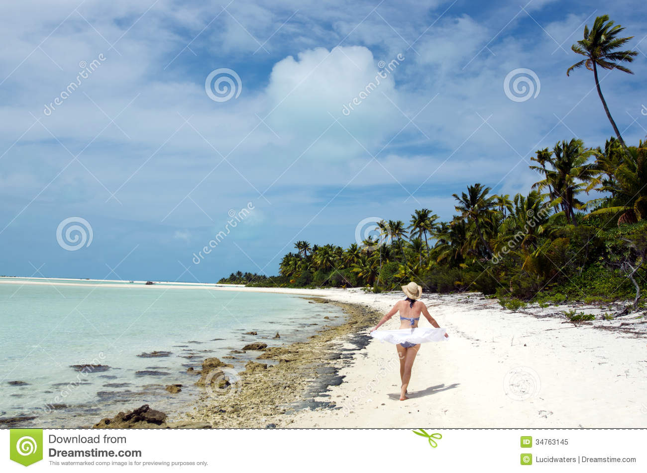 Deserted Tropical Island: Young Woman Relaxing On Deserted Tropical Island Stock