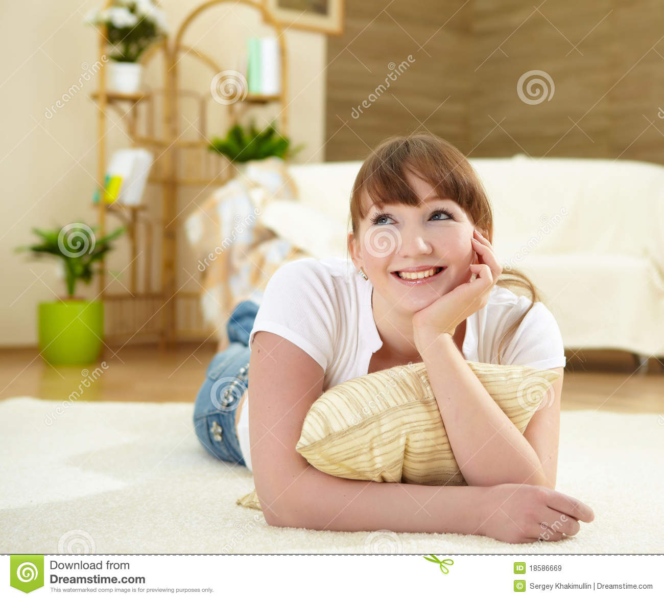 Young Woman Relaxing At Home On The Floor Stock Image