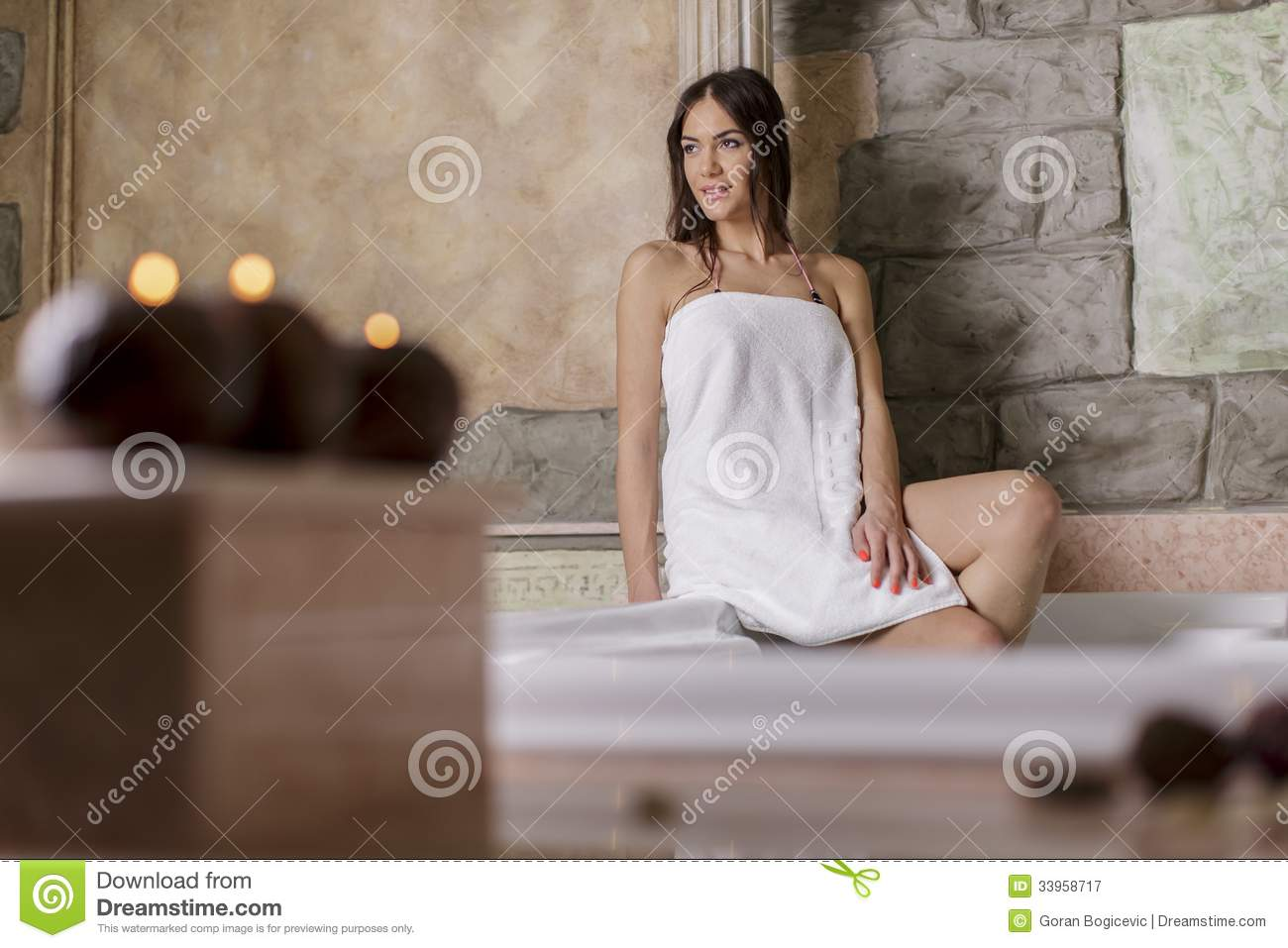 Young Woman Sitting In Bathtub. Rear View Stock