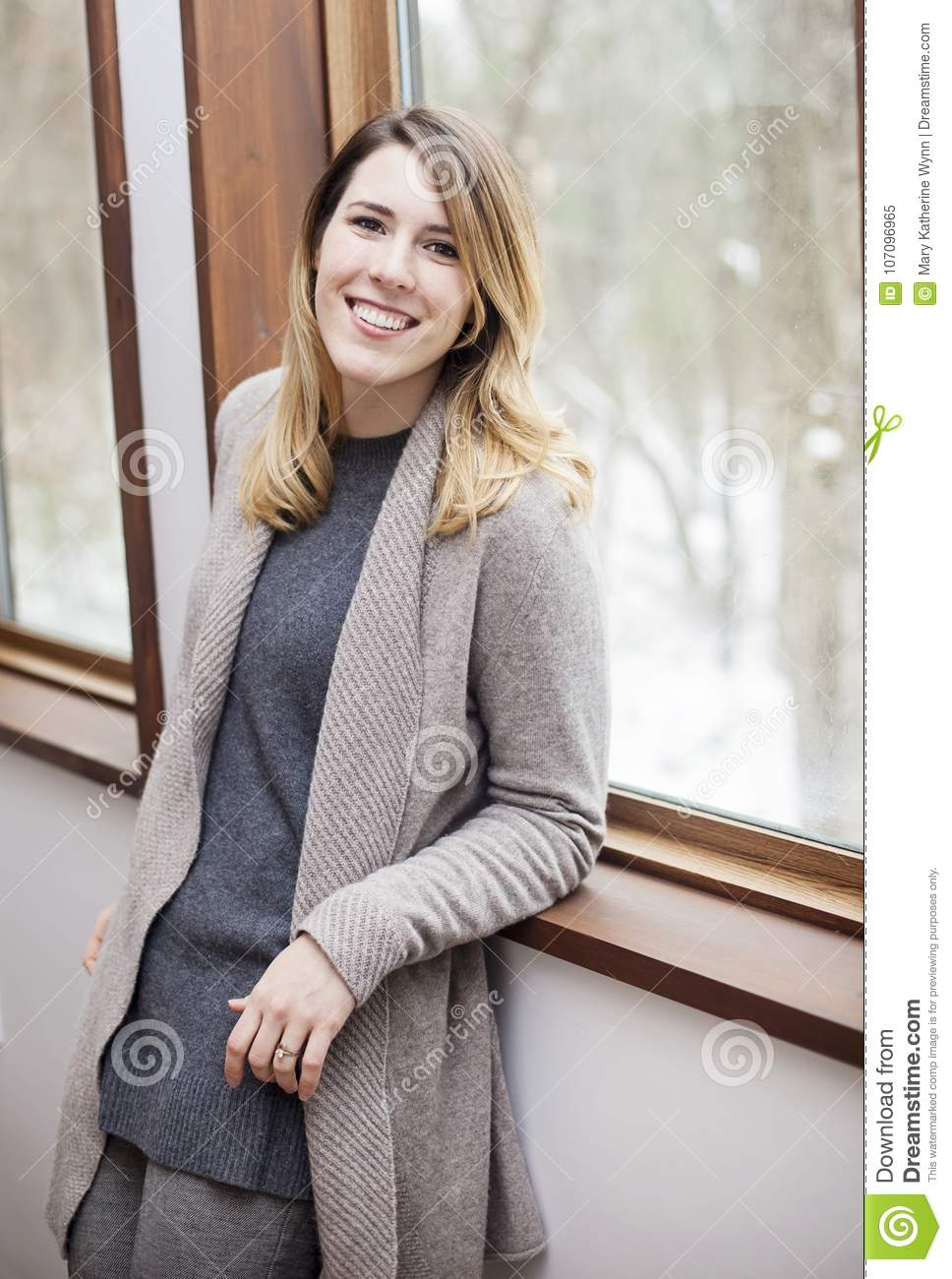 Young woman relaxing indoors in winter