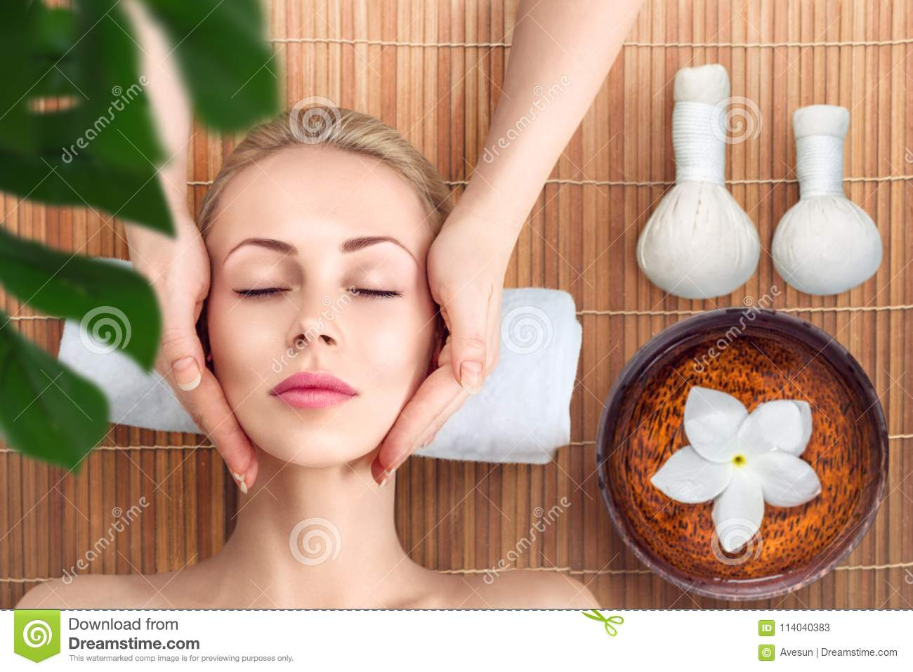 Young woman relaxing with massage in spa