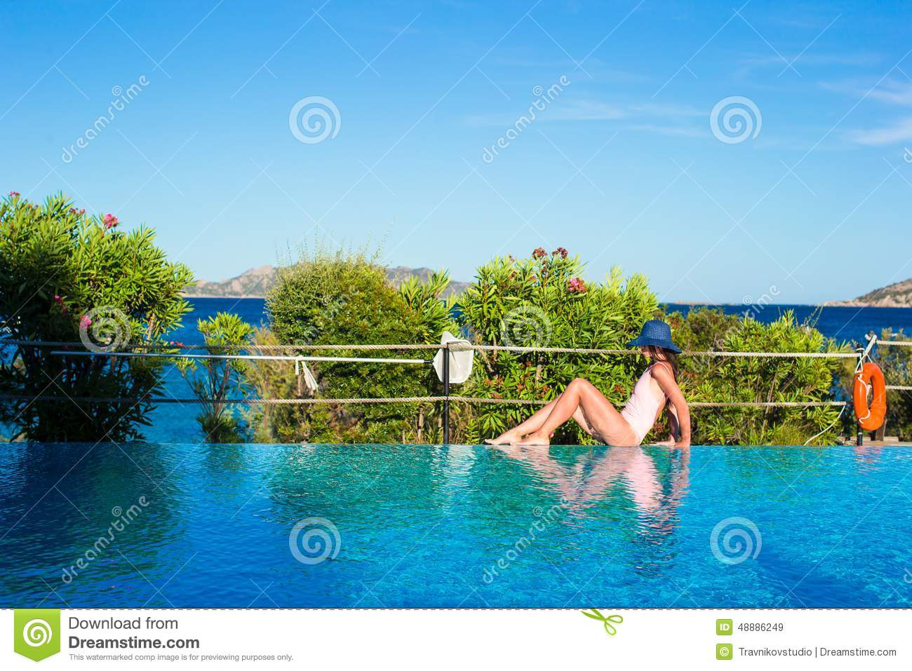 Woman relaxing near swimming pool stock photos 1 292 images - Where is my nearest swimming pool ...