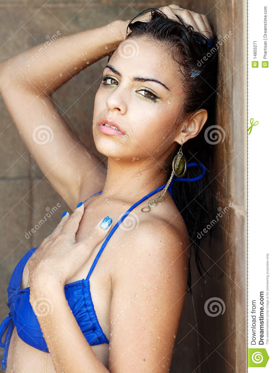 Young woman relaxing in a pool spa shower