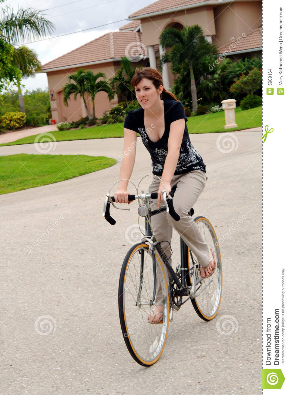 Download Young woman riding a bike stock photo. Image of male, people - 5909164