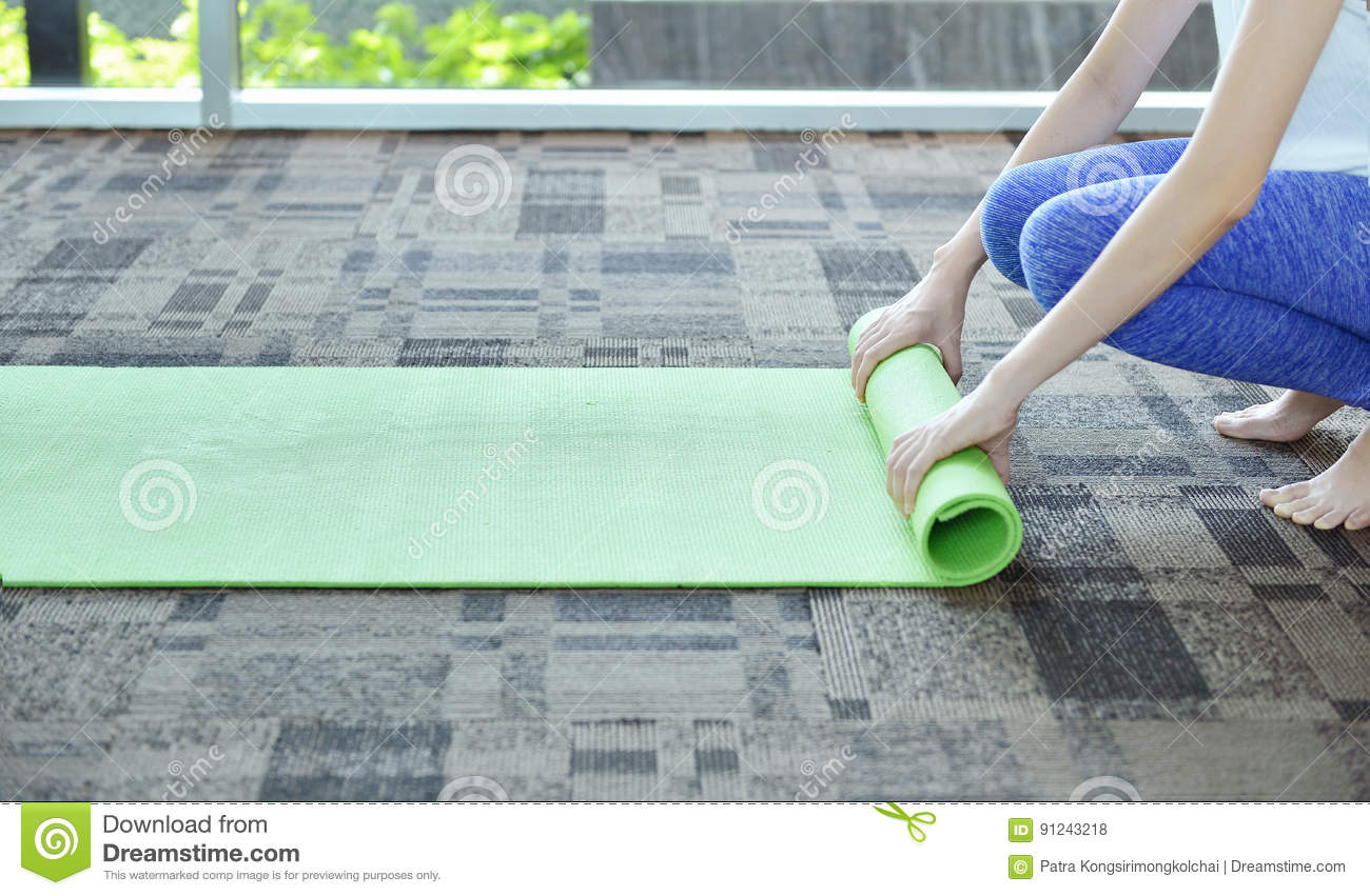 Young Woman Rolling Mat After A Yoga On Carpet Floor Yoga