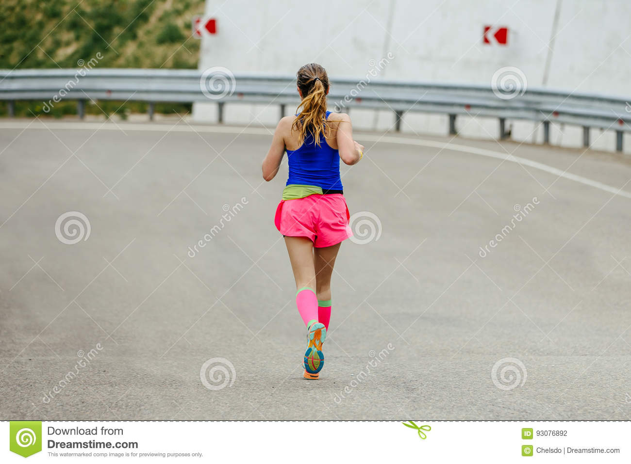 af4791809 Young Woman Runner In Bright Pink Compression Socks Running On ...