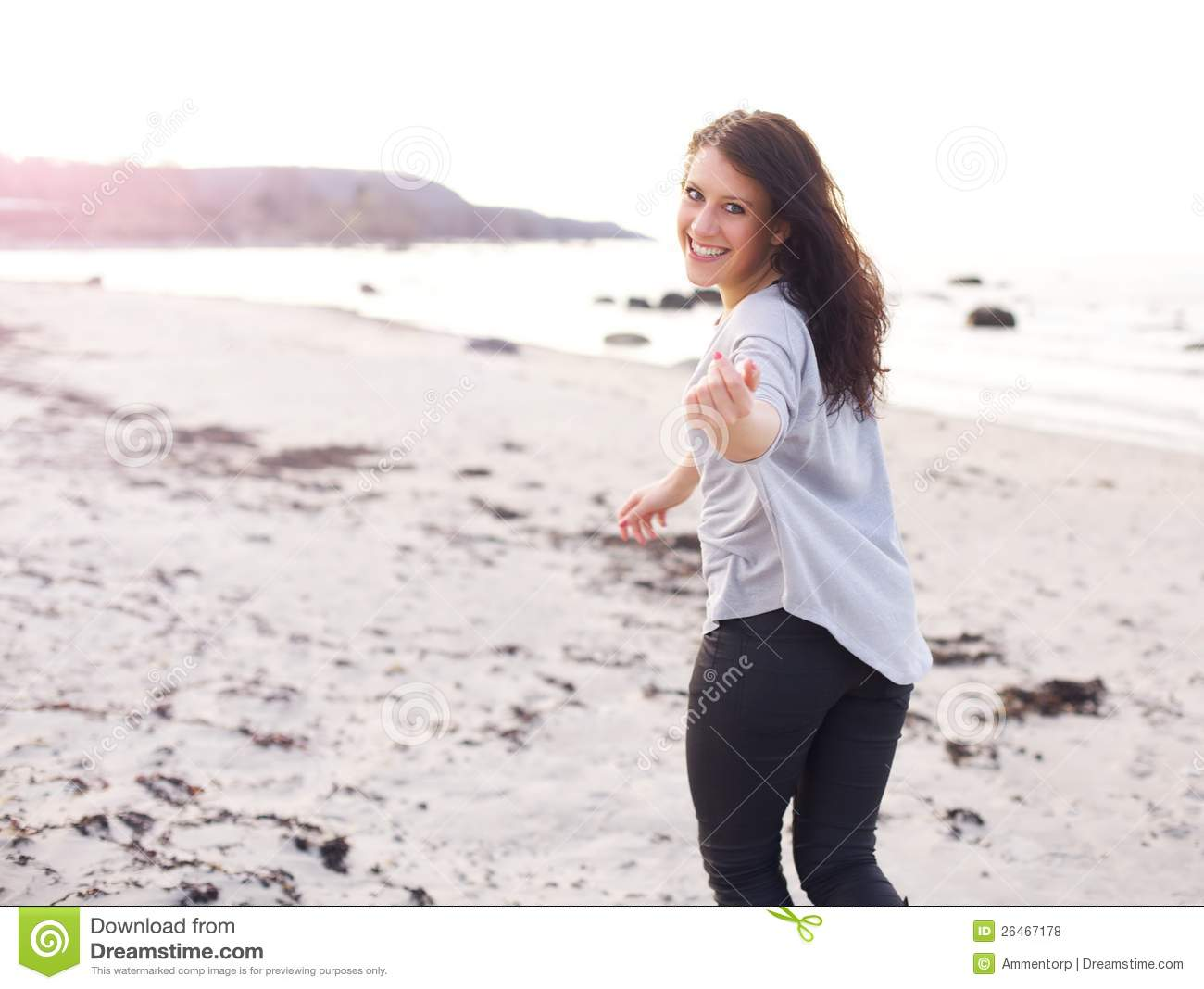 Young Woman Running Inviting You To Come Closer Stock Photo Image