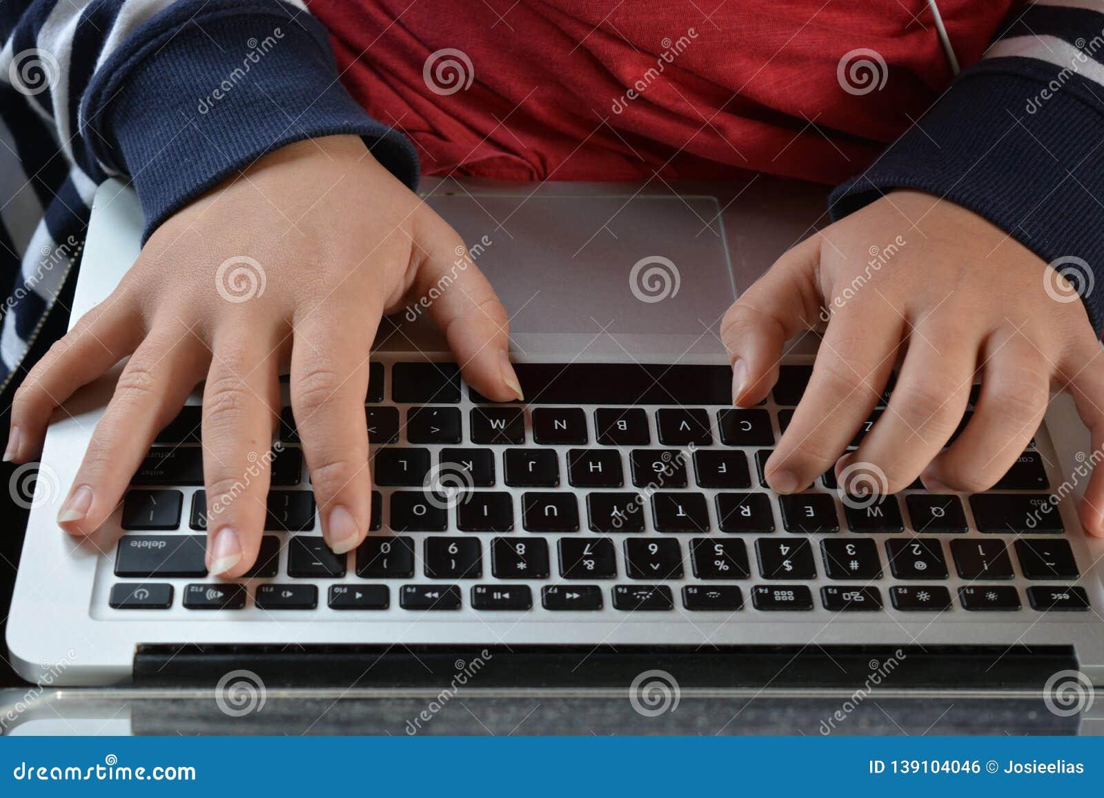 Millennial woman using a laptop computer, close up