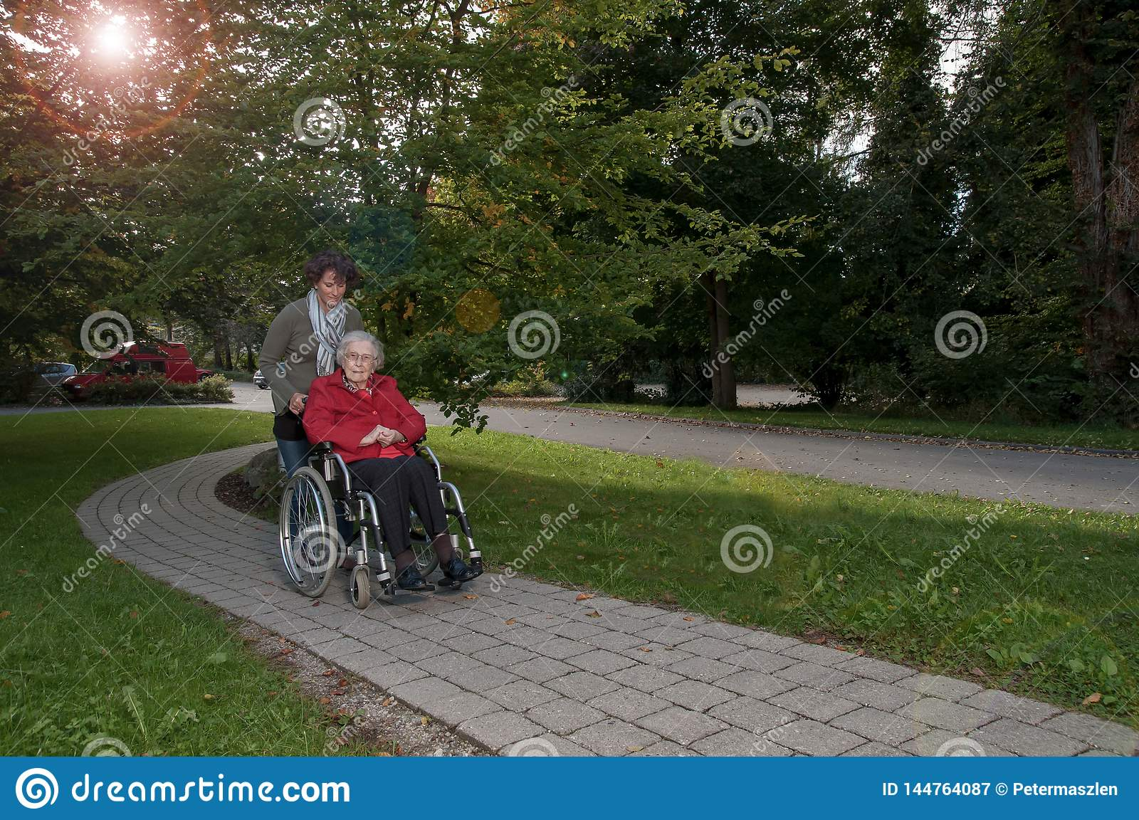 Young woman with senior woman sitting in wheelchair