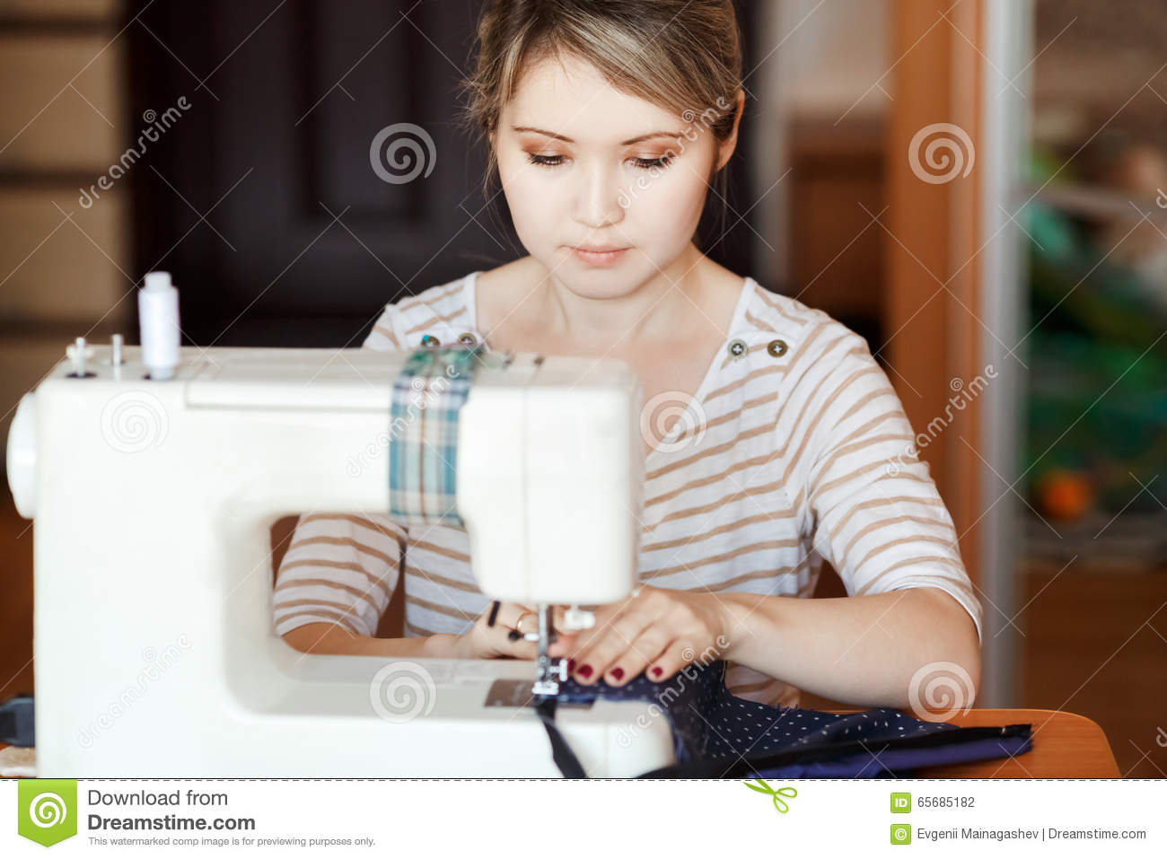 Young Woman Sewing With Sew Machine At Home While Sitting By Her Working Place Fashion Designer Carefully Creating New Stock Photo Image Of Female Creative 65685182