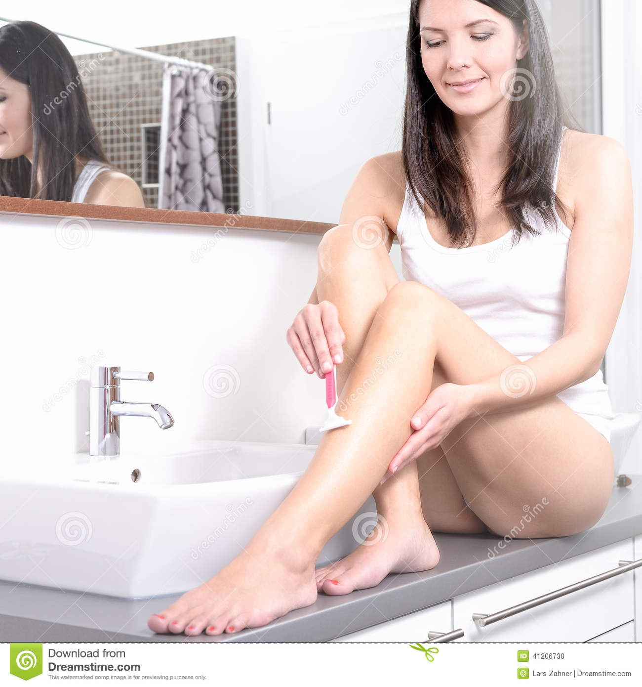 Girl shaving her legs in home movie 3