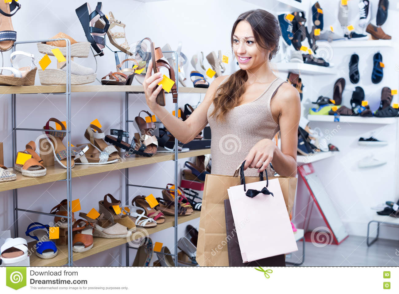 Young woman in shoes store