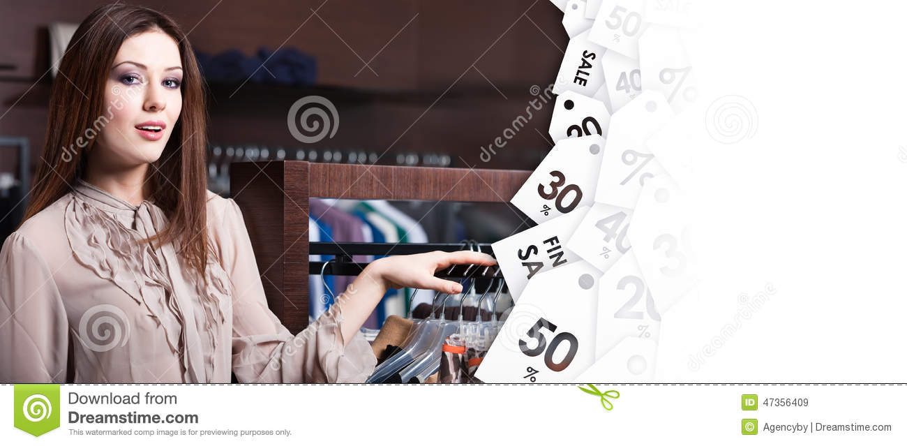 Young woman in the shop on clearence sale