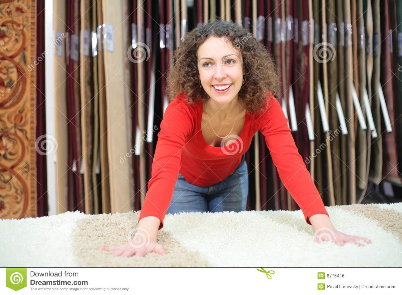 Young woman in shop with fluffy carpet
