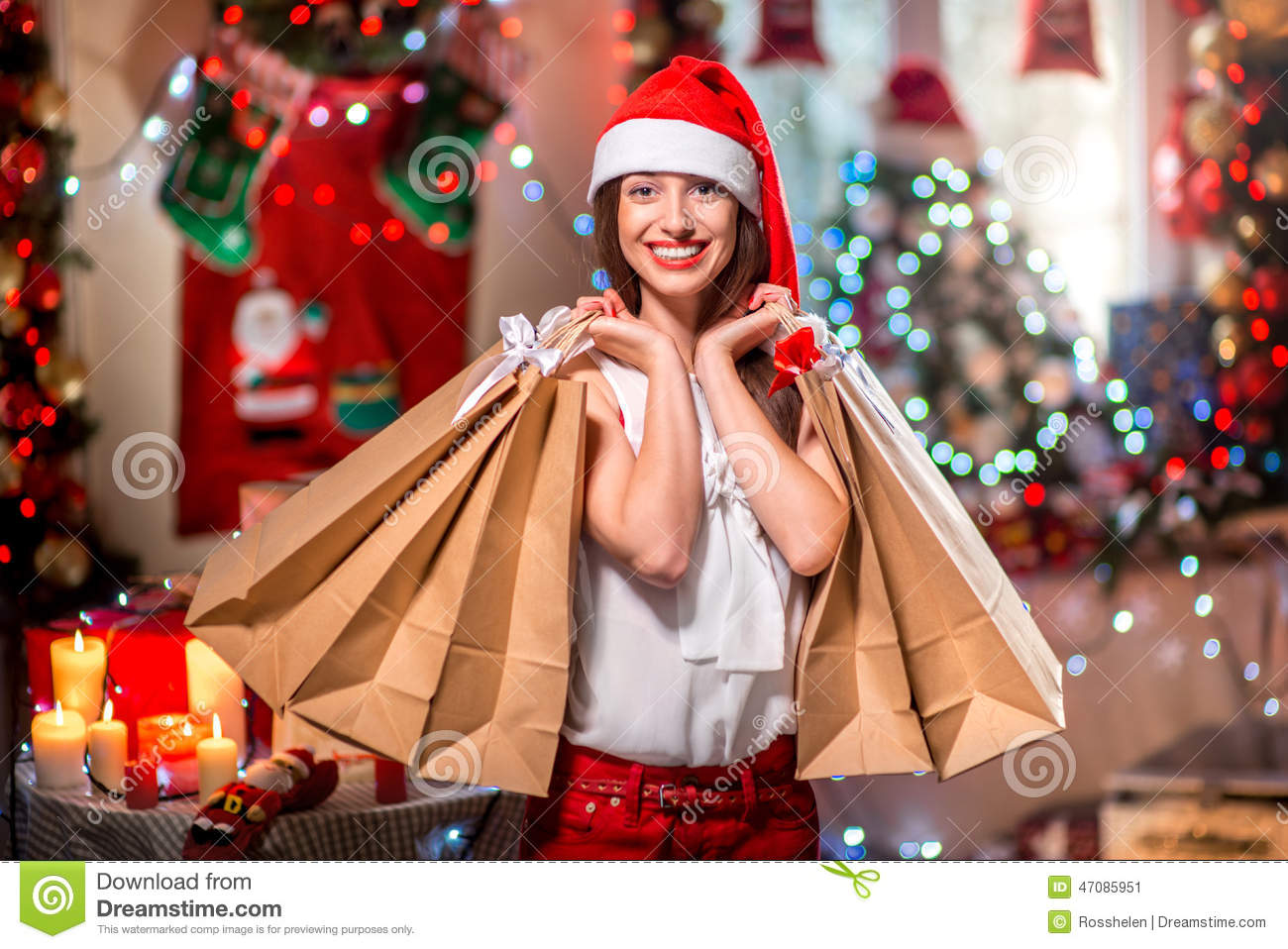 Young Woman With Shopping Bags On Christmas Stock Photo
