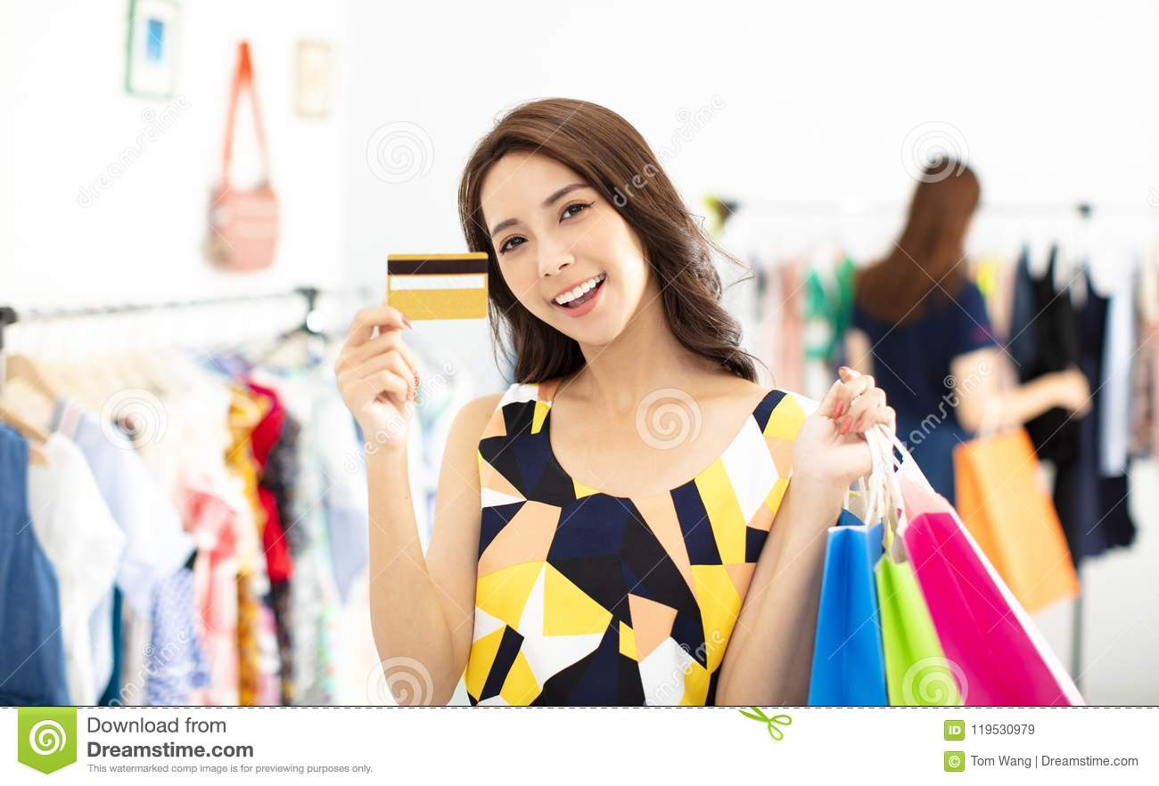 Woman Shopping In The Clothes Store With Credit Card Stock Image