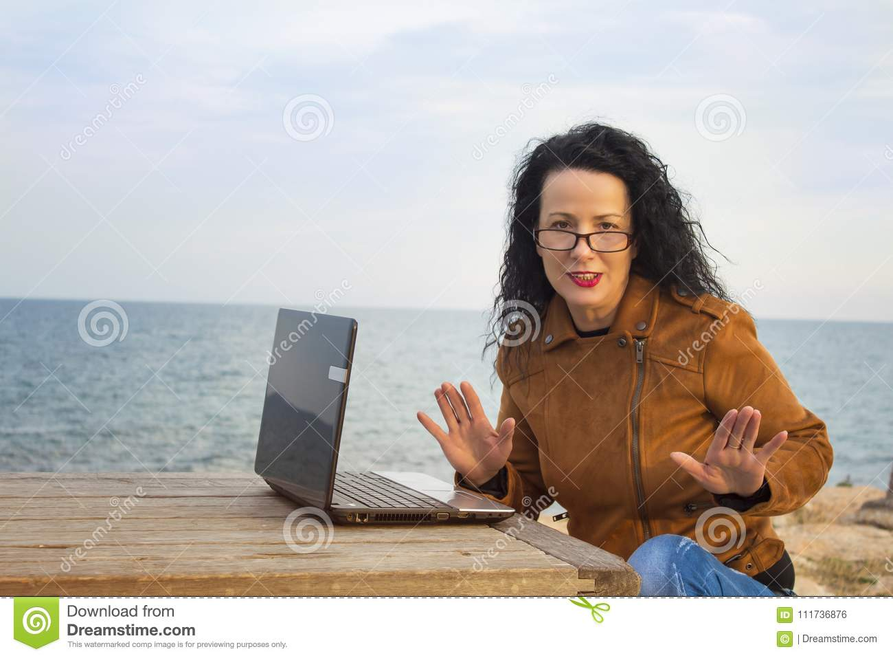 Young woman on shore with computer.4
