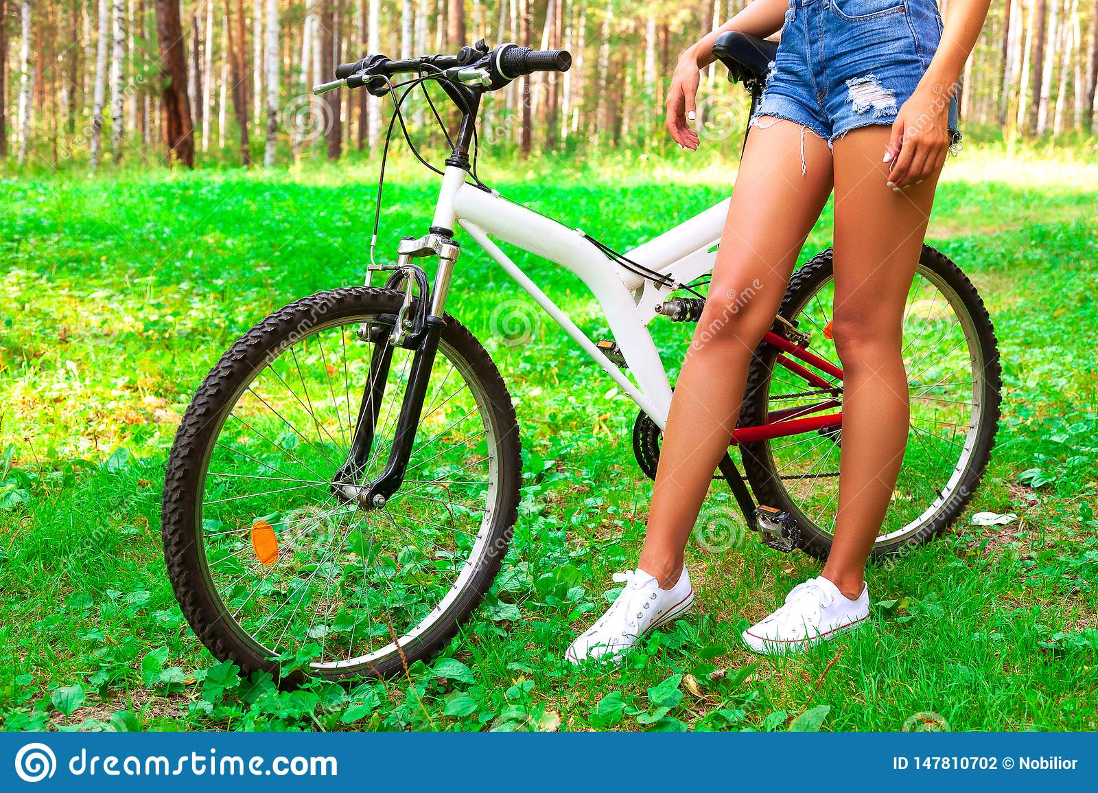Young woman in shorts riding a sportbike