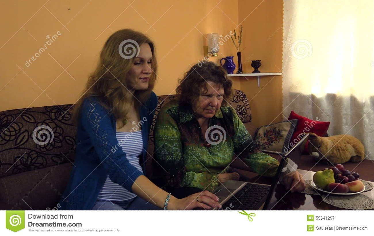 Young woman show her grandma how use computer two generation stock young woman show her grandma how use computer two generation stock video video of adult monopod 55641297 ccuart Gallery