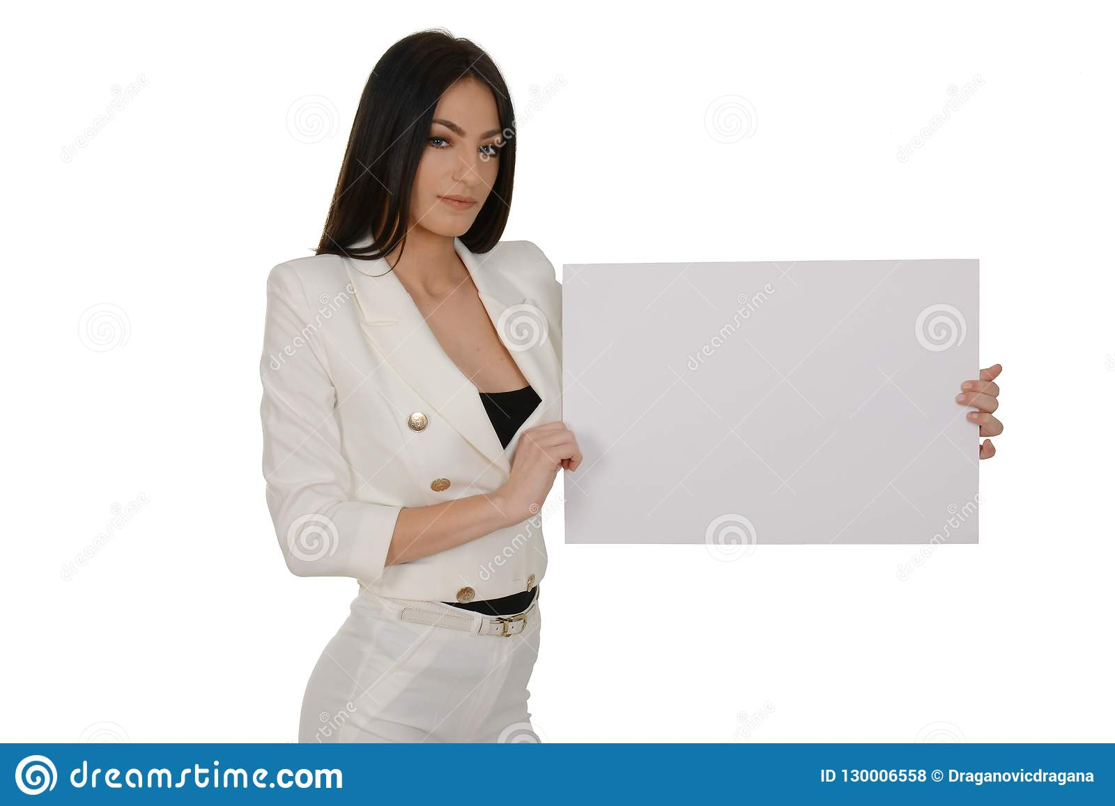 Young woman showing blank signboard or copy-space for slogan or text, over white background
