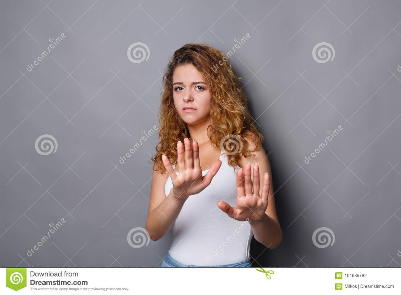 Young woman showing rejection sign