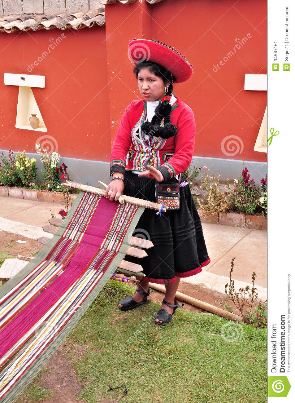 Young Woman Shows And Tells About Production Of The Clothes. Editorial Photo - Image: 34547151