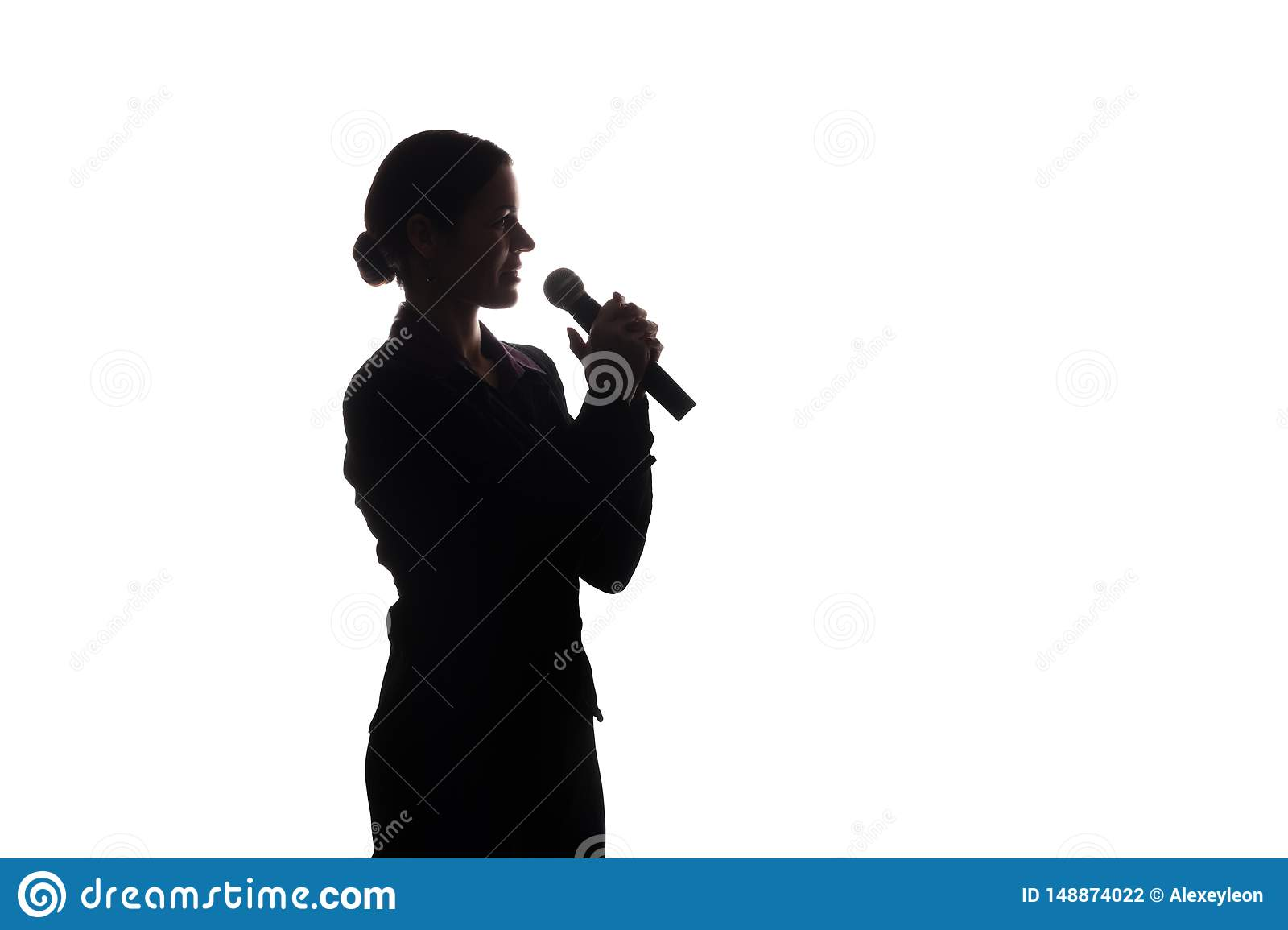 Young woman singing into the microphone