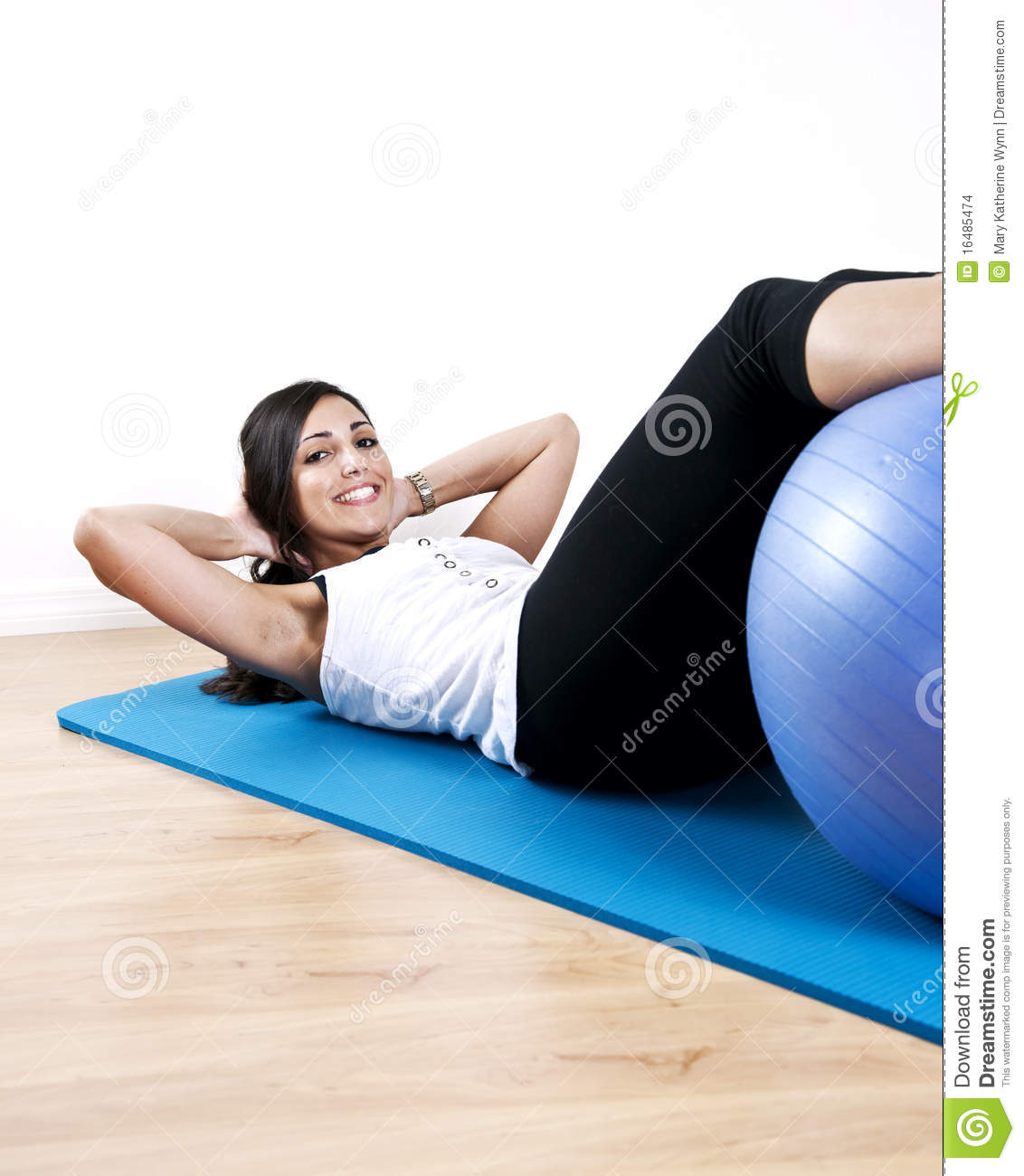 Young Woman Sit Up With Ball Stock Photo